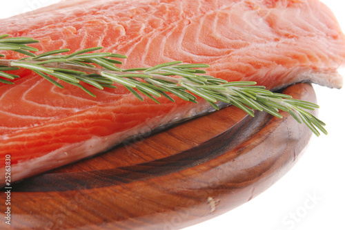 big salmon fillet on wood with rosemary