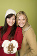 Women holding gingerbread man