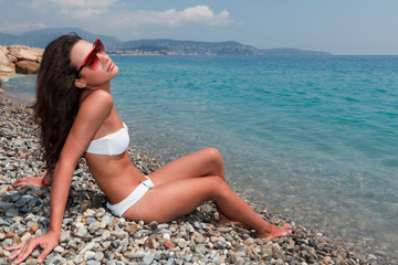 Beautiful young woman enjoying the French Riviera