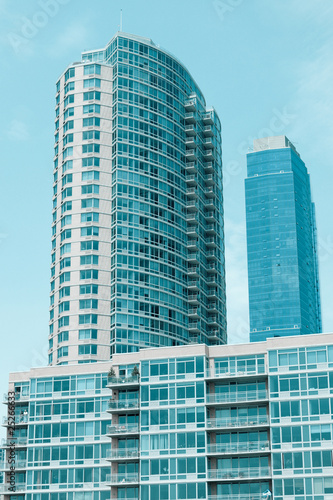 facade of modern apartment building with reflection of blue sky