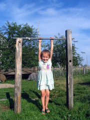 The girl on a horizontal bar