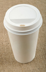 Paper coffee cup with safety cardboard collar.