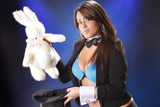 Cute magician and plush bunny out of her top hat poster