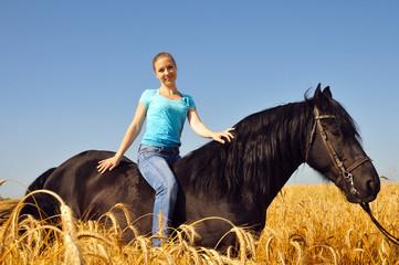 Beautiful gitl in the field on horseback