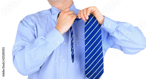 Stressful businessman untying his necktie