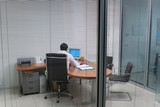 Image of man at work in office