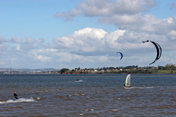 kitesurfer and windsurfer