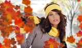 Beautiful woman wearing hat and gloves and maple leaves