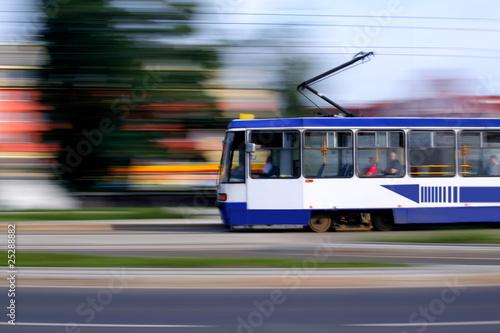 Old blue tram rider fast on rails, Wroclaw, Poland - 25288882