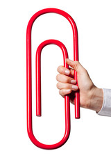Hand holding giant paper-clip