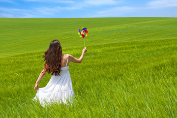 girl in a green field, enjoying nature