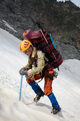 Hicker with backpack and ice-axe