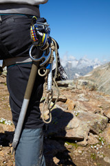 Hiker with climbing equipment