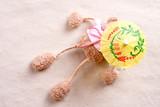 plush toy under the beach umbrella poster