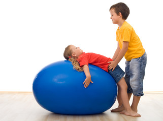 Trust my sister - kids playing with large rubber ball