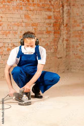 Grinding the cement floor