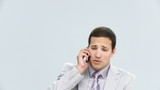 assertive businessman talking on phone