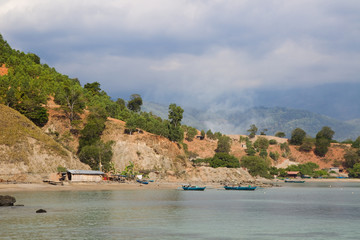 Native fishing village with boats on water