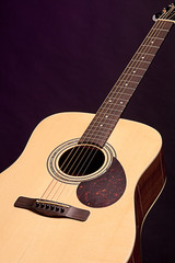 Acoustic Guitar Isolated On Black