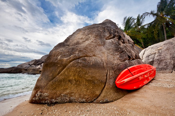 red kayak at the tropical beach