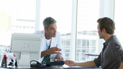 male doctor talking to his patient during an appointment
