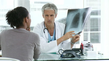 male doctor explaining x-ray to his female patient