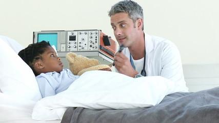 confident doctor looking patient's ears