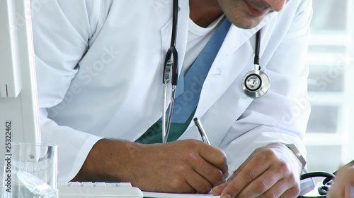 close-up of a doctor writing a prescription