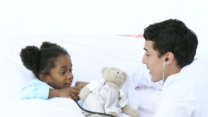 doctor talking with a cute african patient at the hospital