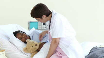 nurse talking with a little boy