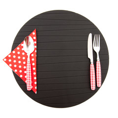 Place mat with red cutlery