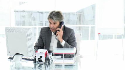 businessman celebrating a success after a call