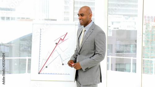 handsome businessman showing results during a presentation