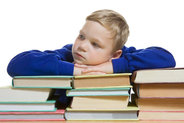 young boy with hands on top of books, isolated