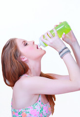 Girl drinking water from plastic bottle