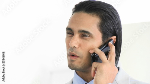 portrait of a charismatic businessman on phone