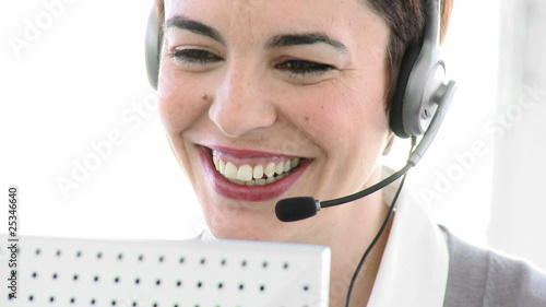 close-up of a cheeful woman on phone in a call center