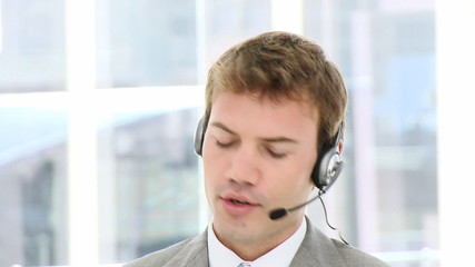 businessman using headset in his office