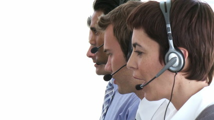 four people working in a call-center