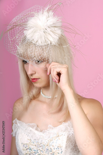 beautiful blonde in an extravagant hat