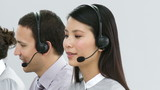 close-up of an asian woman working in a call-center