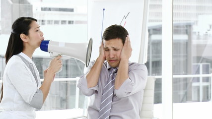 young woman discouraging her colleague using a megaphone