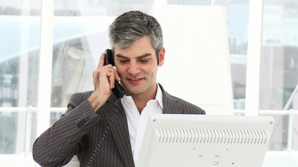 Smiling businessman calling by phone