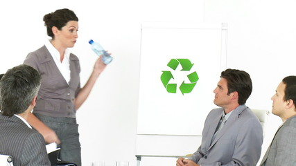 Beautiful businesswoman presenting the concept of recycling