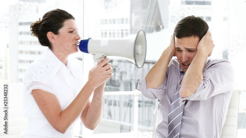 caucasian woman using a megaphone