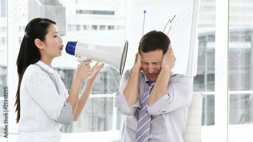 asian businesswoamn complaining using a megaphone