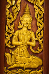 Masterpiece of wood caving in traditional Thai style