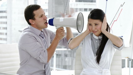 businessman  yelling through a megaphone