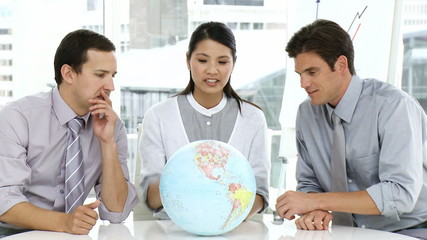 three young business people speaking about globalization