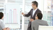 mature businessman presenting stats